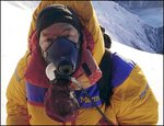 Nils Antezana wears an oxygen mask during one of the last phases of his summit.